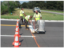 Picture of workers Applying a Road Stripe