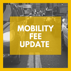 Picture of vehicles with Mobility Fee Update overlay in yellow